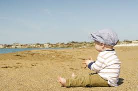Boy sitting on the beach